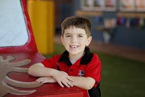 student leaning on playground