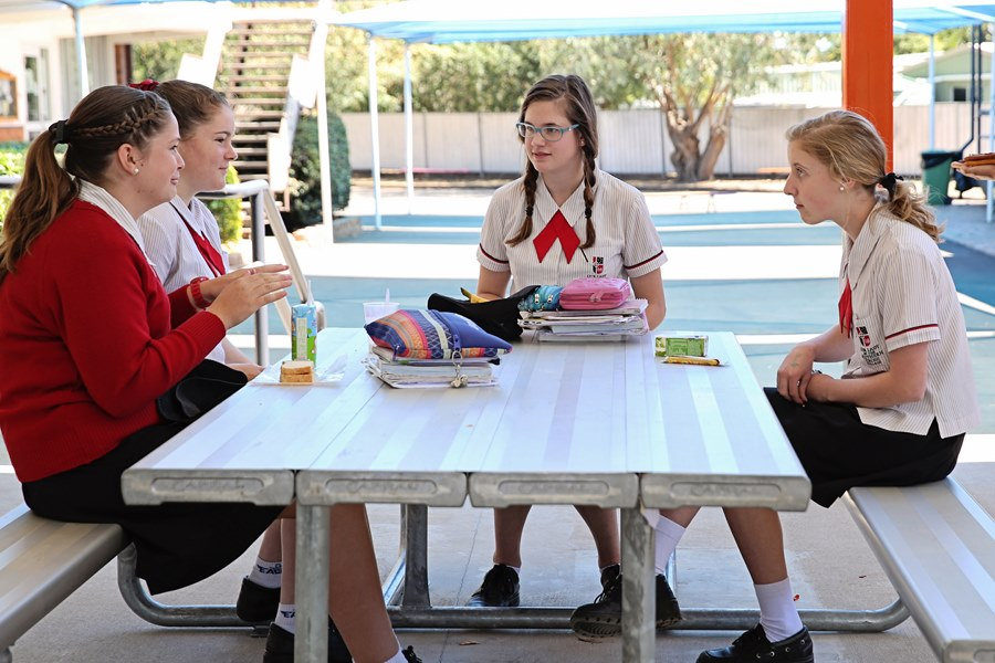 students sitting at table