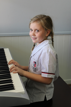 student playing the Keyboard