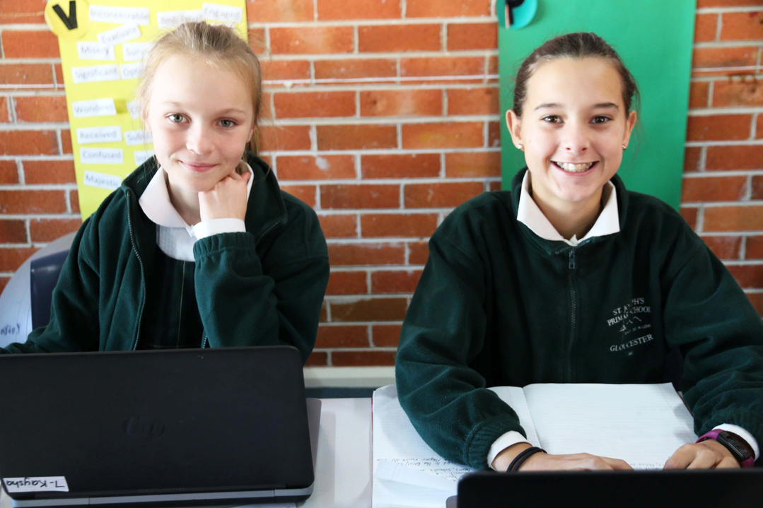 students on their laptops